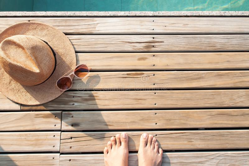 Selfie of barefoot on wooden floor with sun hat and sunglasses. Summer concept. Selfie of barefoot on wooden floor with sun hat and sunglasses. Summer vacation stock photos