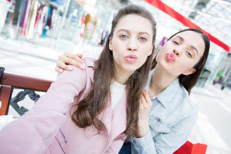 Fashion girls puckering lips for selfie stock photography
