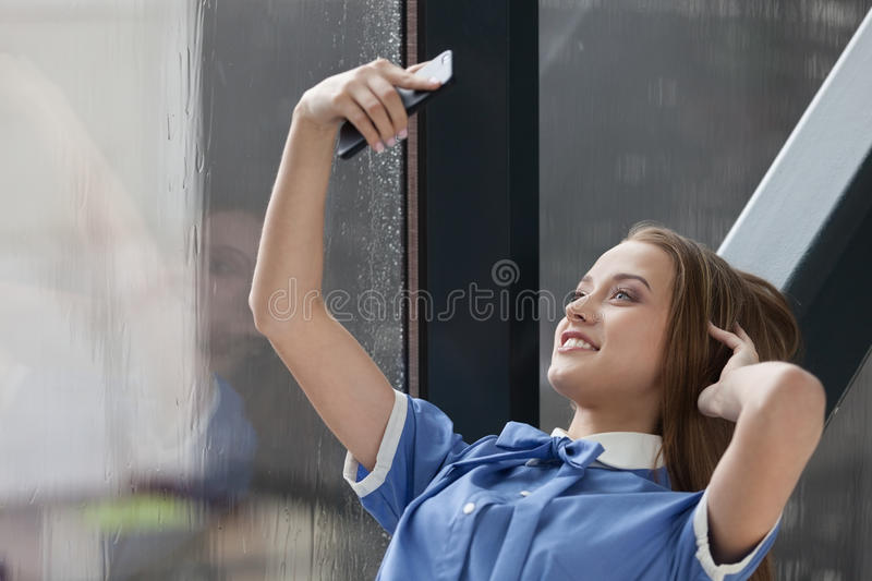 Selfie. Beautiful smiling student taking selfie royalty free stock photography