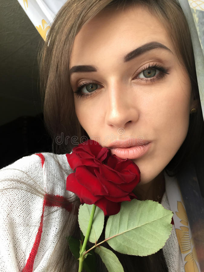 Selfie beautiful young girl with Rose stock photography