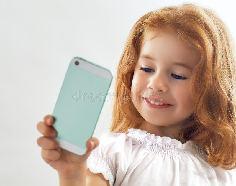 Selfie. A beauty child taking selfie royalty free stock photography