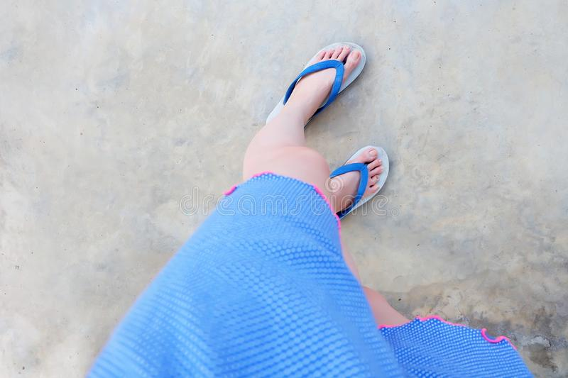 Selfie Blue Shoes on Concrete Floor for Top View. Woman's Feet Wearing Blue Pajamas and Flip Flop Slippers on The Cemen. T Floor Background Great For Any royalty free stock image