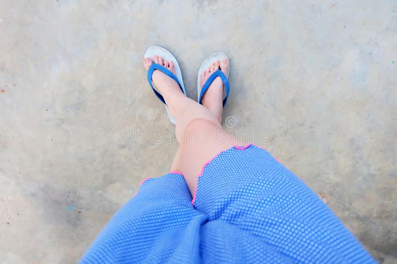 Selfie Blue Shoes on Concrete Floor for Top View. Woman's Feet Wearing Blue Pajamas and Flip Flop Slippers on The Cemen. T Floor Background Great For Any stock image