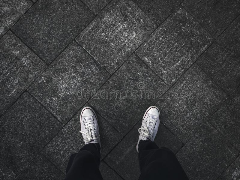 Selfie of feet in sneaker shoes stock images