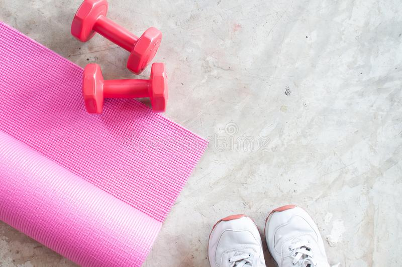Selfie of feet sporty girl with yoga mat and dumbbells on concrete floor. Fitness and workout, Healthy. Concept royalty free stock photos