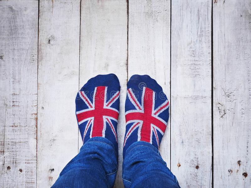 Selfie feet wearing socks with British flag pattern royalty free stock photography
