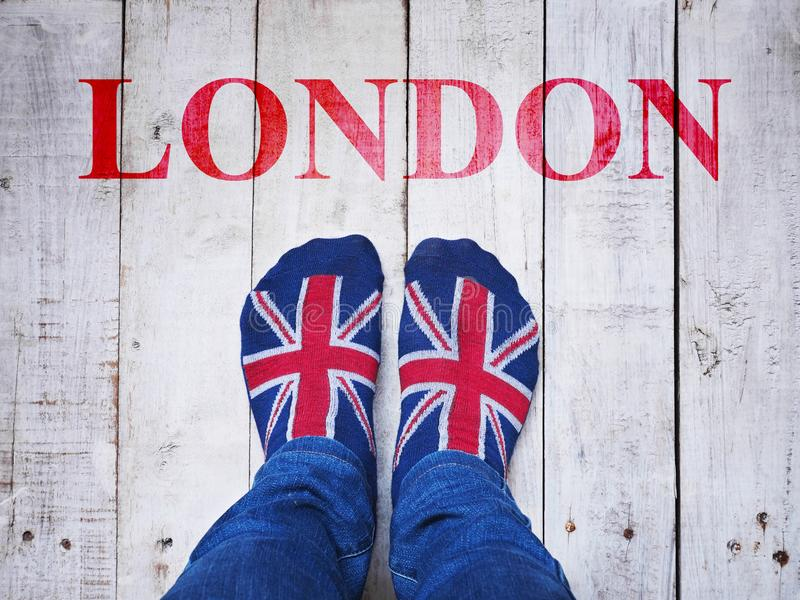 Selfie feet wearing socks with British flag pattern royalty free stock images