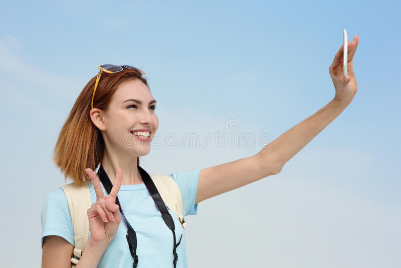 Selfie felice della presa della donna di viaggio immagini stock