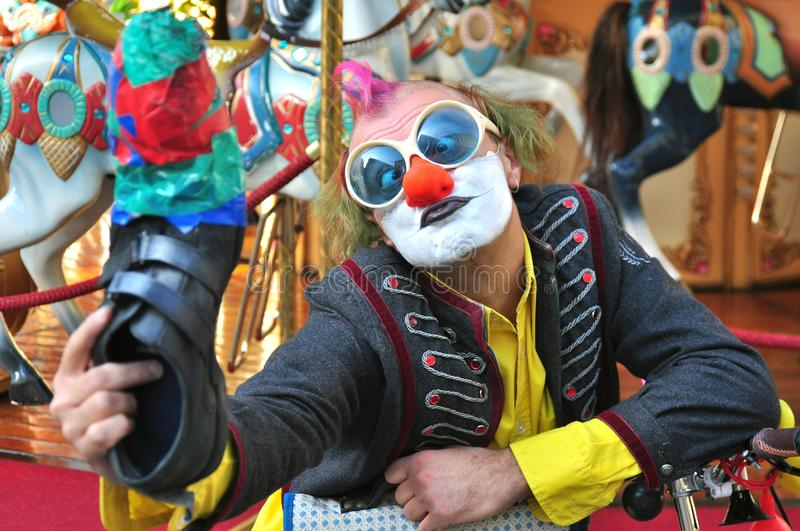 Selfie of a funny street artist in Florence , Italy. Street artist in Florence , Italy. clown male doing a show on the streets. Italian clown while using one royalty free stock image