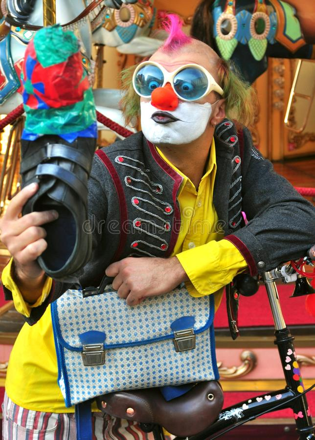 Selfie of a funny street artist Italy. Street artist in Florence , Italy. clown male doing a show on the streets. Italian clown while using one shoe to take a stock photography