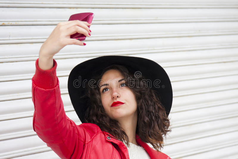 Selfie girl. On the street royalty free stock image