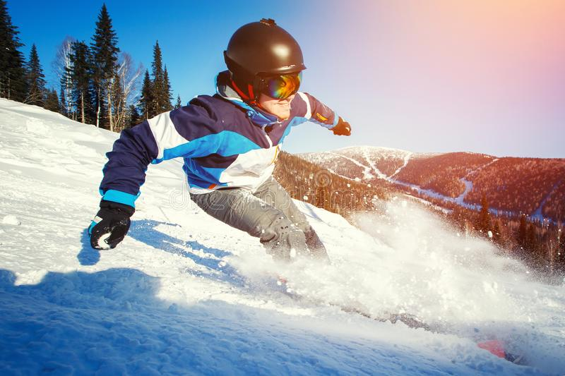 Selfie Guy sportsman goes on normal skiing on ski slope with action camera stock image