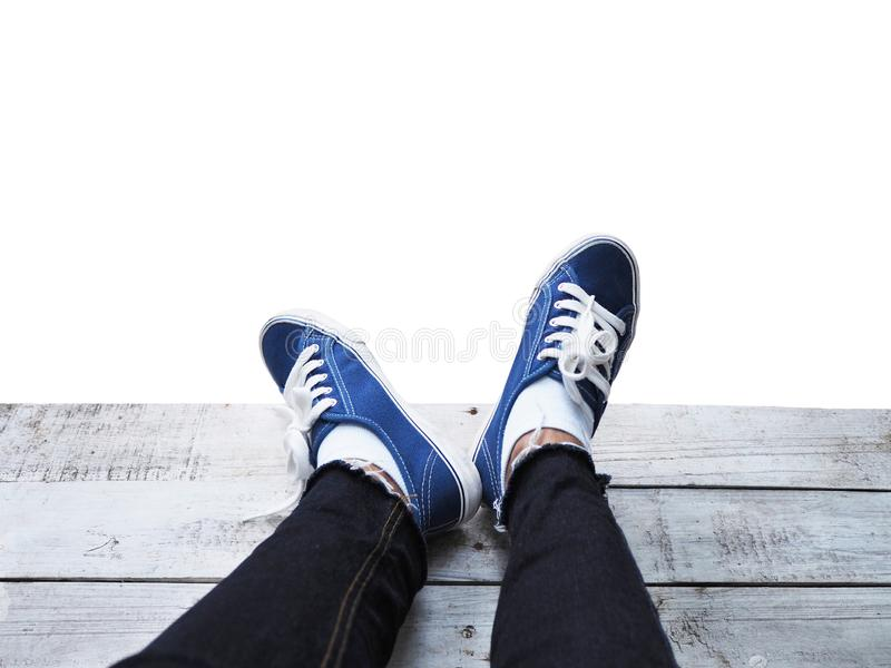 Selfie hipster feet on wooden floor isolated on white backgroun royalty free stock image
