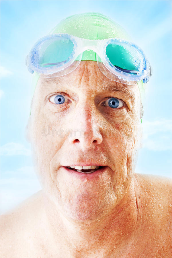 Selfie Swimming Fitness Health. A selfie portrait of a middle age man who has just been swimming and is wet. Wearing a swim cap and goggles... I like to swim stock photo