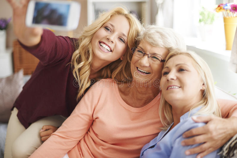 Selfie with mom and grandma. Blonde girl taking selfie with mom and grandma