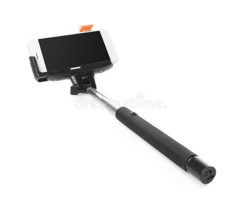 Selfie pinne med mobiltelefonen royaltyfri bild