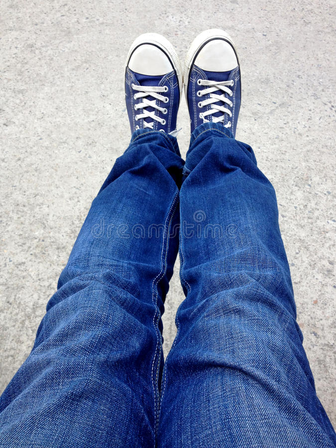 Selfie shot seen from above with blue jeans and shoes. Selfie shot of blue jeans and shoes stock image
