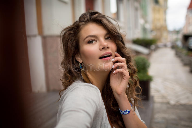 Selfie shot of young travel woman with nice street on the background. royalty free stock photos