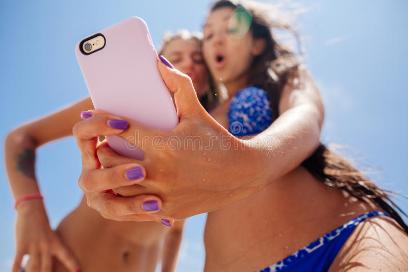 Selfie smartphone girls beach royalty free stock photos