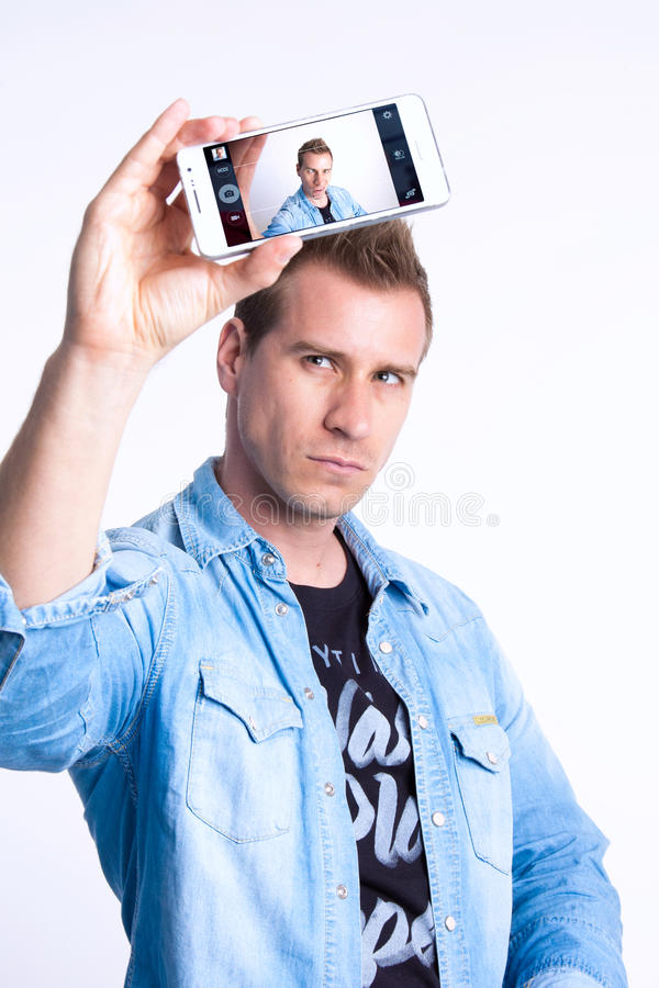 Selfie. With smartphone, notion and reality stock images