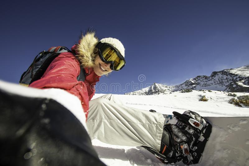 Selfie snowboarder. Young happy woman taking selfie on a slope in North Alps, France. royalty free stock images