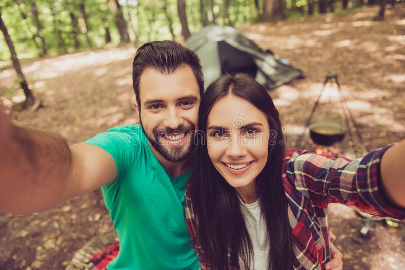 Selfie time! For a memories of vacation together. Cute lovers ar stock photography