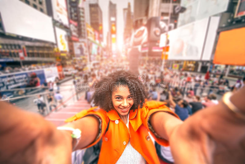 Selfie at Times Square, New York. Pretty woman taking a selfie at Times Square, New York - Afroamerican girl taking a memorable self portrait with smartphone royalty free stock photos