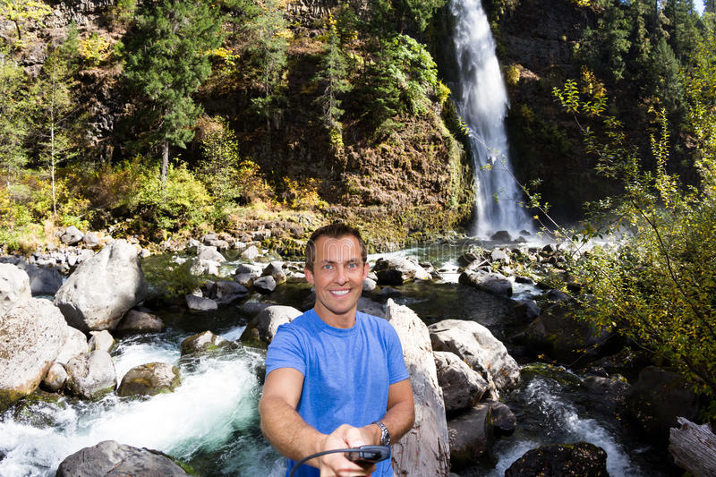 Selfie with a waterfall royalty free stock photos