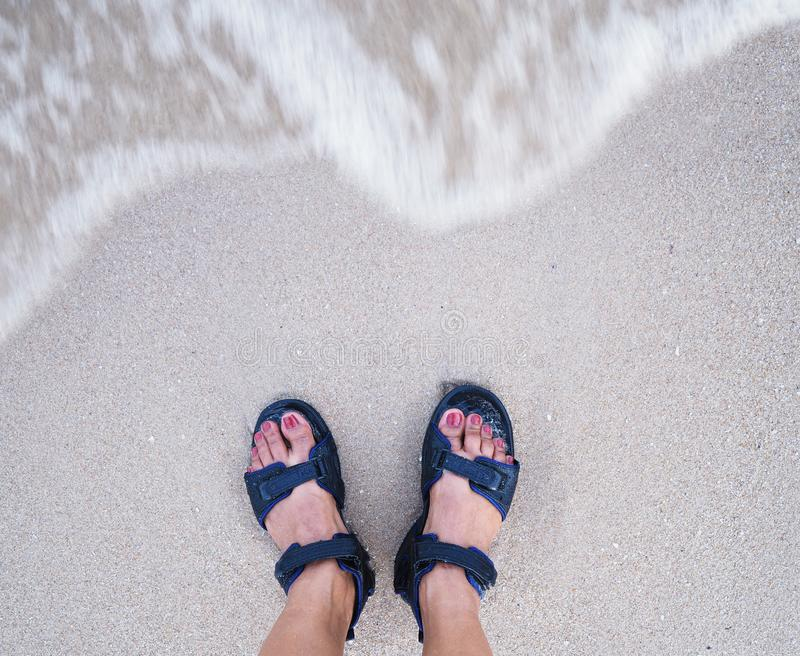 Selfie woman feet on beige sand summer beach background royalty free stock images