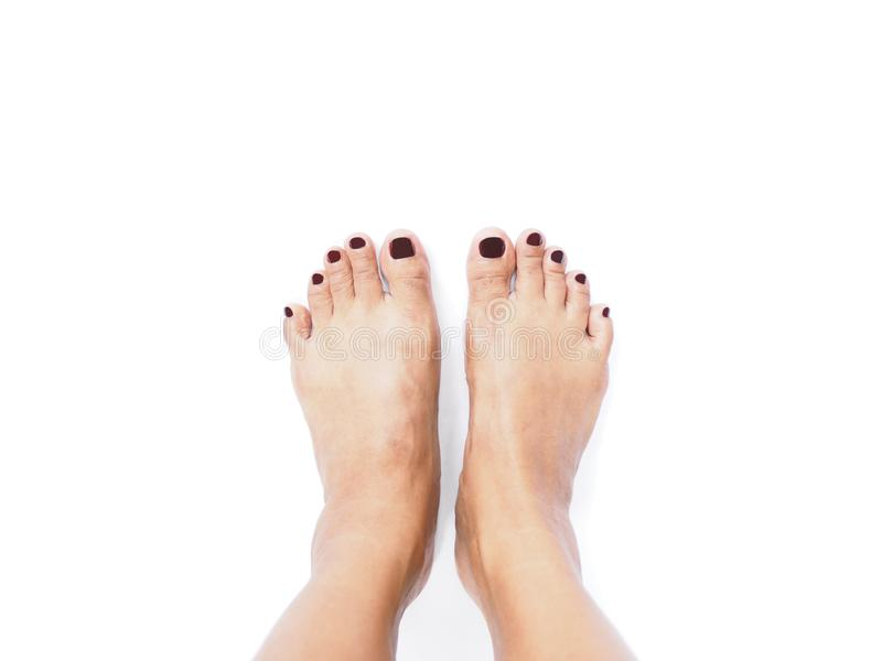 Selfie woman feet isolated on white background. royalty free stock photo