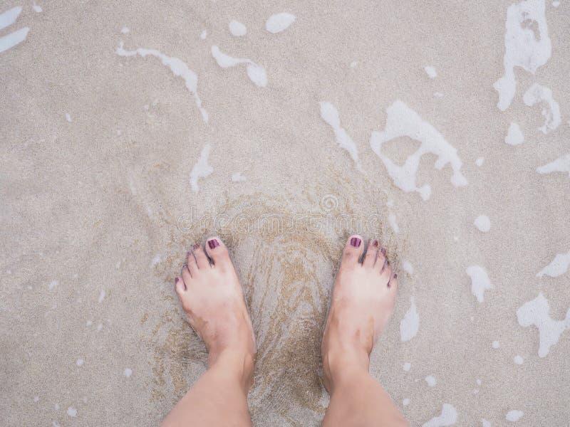 Selfie woman feet on summer beach background stock photography