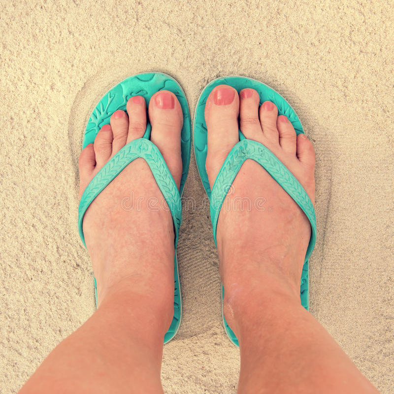 Selfie of woman feet wearing flip flops on a beach stock photography