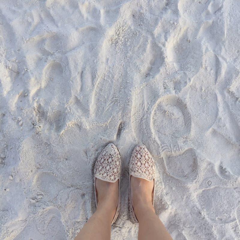 Selfie of woman feet wearing flip flops on a beach. Vintage process stock image
