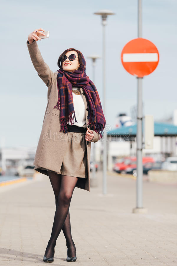 Selfie. Woman taking selfie in the harbor in front of the no entry sign stock images
