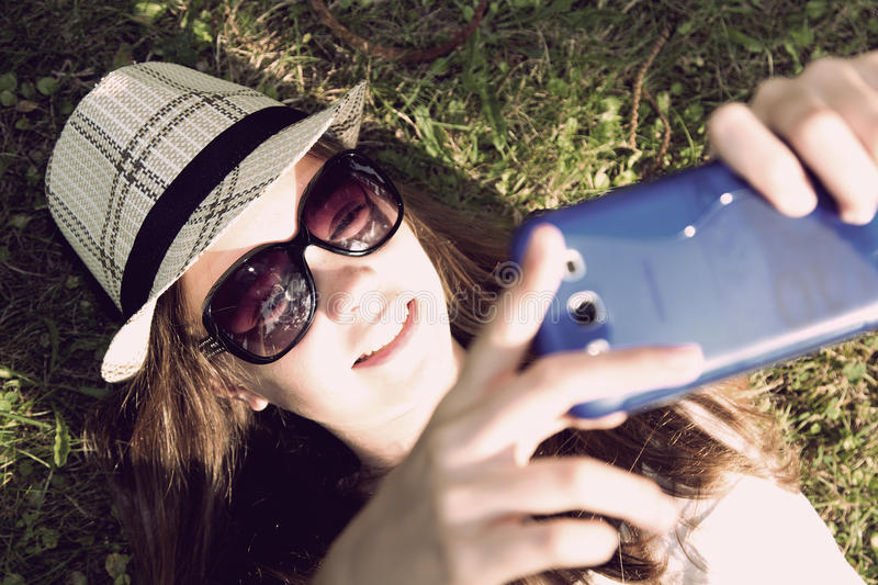 Selfie. Young becoming a selfie, instagram effect, lifestyles stock images