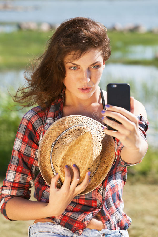Selfie. Young woman making selfie outdoors stock image