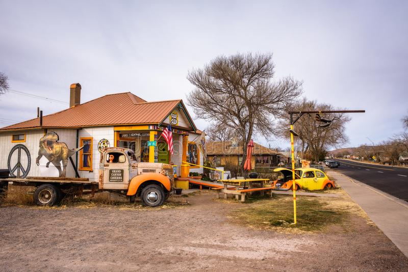 Old cars left abandoned at a souvenir shop on route 66 in Arizona royalty free stock images