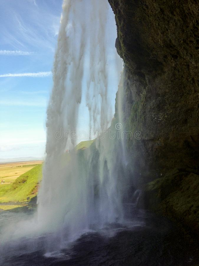 Iceland. Nature and Landscapes. Seljalandsfoss, the popular Icelandic waterfall near Hamragardar in the south of the island. The water jump seen from the back stock photography