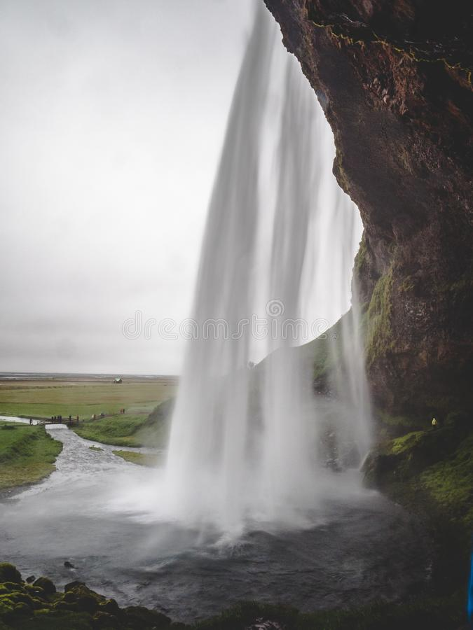 Seljalandsfoss waterfall in Iceland Passage under the waterfall long time exposure, vertical royalty free stock image