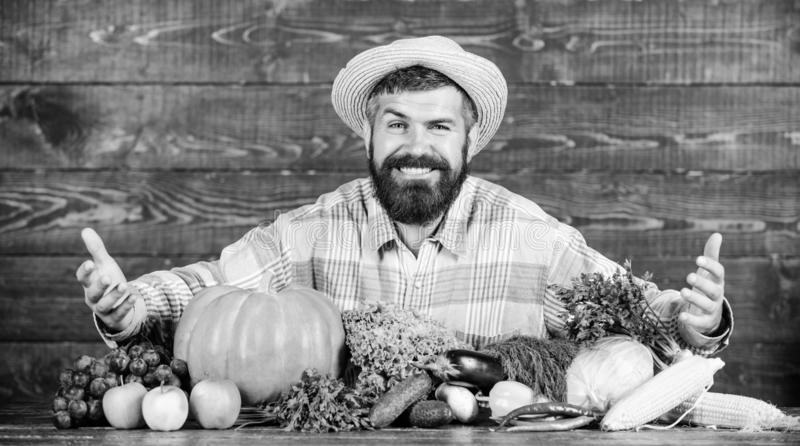 Sell vegetables. Man bearded farmer with vegetables rustic style background. Buy vegetables local farm. Locally grown. Crops concept. Local market. Homegrown stock image