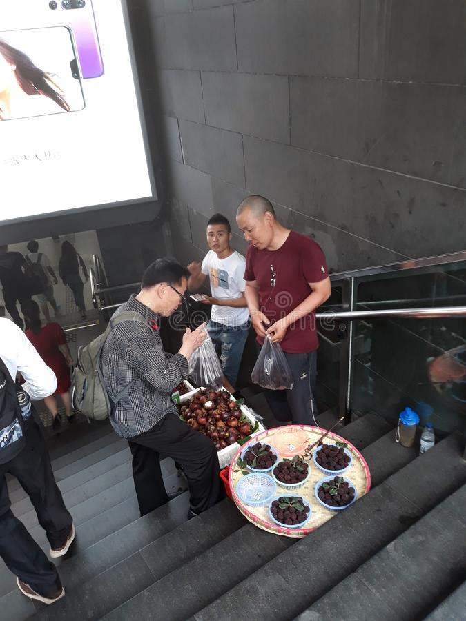 Selling fruit in the Chinese subway. stock photo
