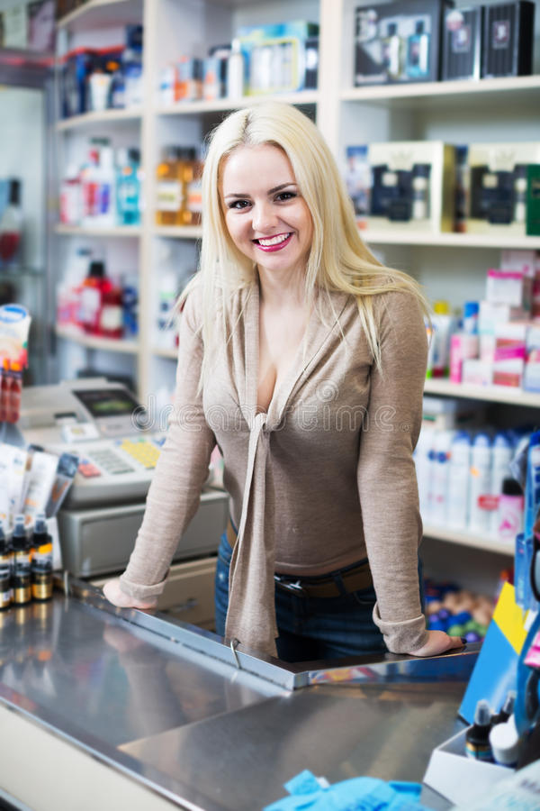 Seller in cosmetic shop stock photography