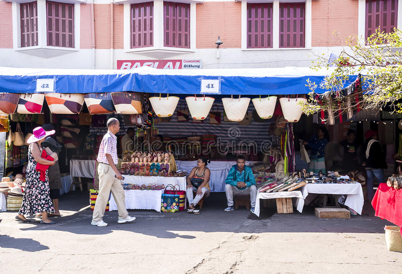 Seller of craft products. On the street market in Madagascar royalty free stock image