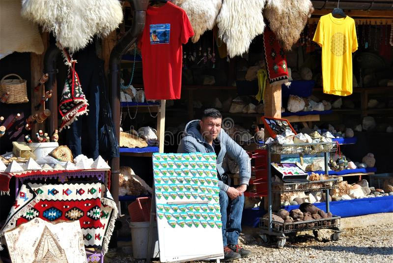 Seller/ Dealer. Dealer/seller: Handicrafts and souvenirs; Scene in front of tunnels on the Bosnian Pyramid Sun in Visoko, Bosnia and Herzegovina, 3.3.2017 royalty free stock photo