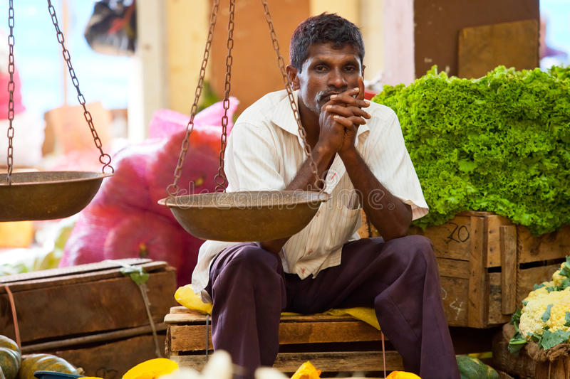 Seller on local market in Sri Lanka - April 2, 2014 royalty free stock images