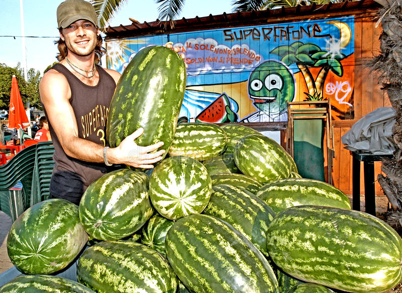 The seller of watermelons. Civitavecchia Rome In summer it is tradition to eat and taste a slice of watermelon along the main street where there are some sales