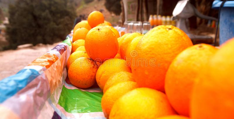 Sellers of oranges on streets. In Morocco stock photos