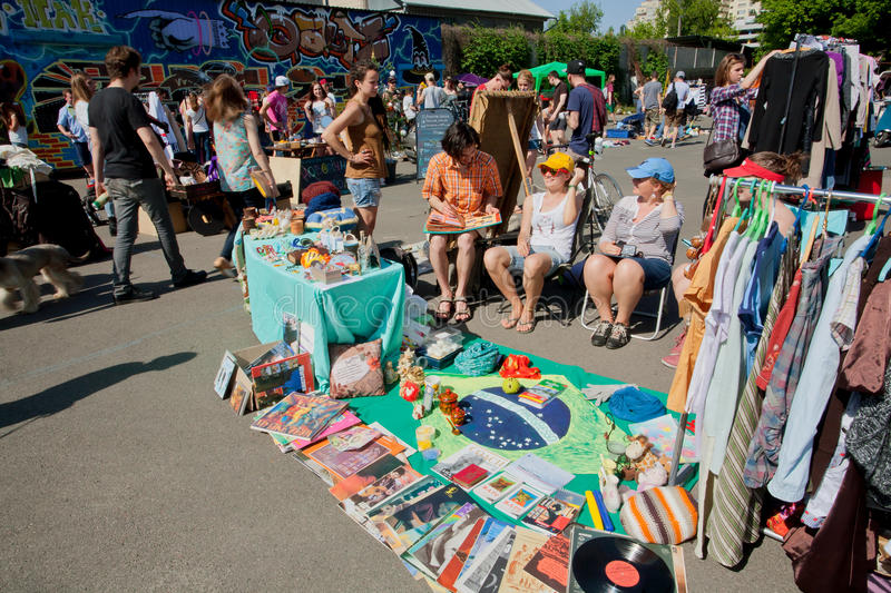 Sellers of second hand bazaar wait for the customer royalty free stock photography