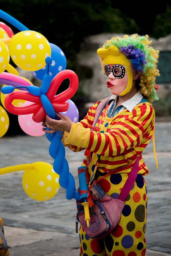 Selling the balloons. A woman disguised as a clown selling the balloons in hubei province, china stock photos