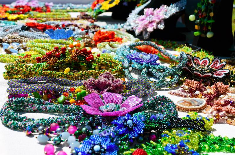 Selling beautiful colorful women`s jewelry from beads. Fair - an exhibition of folk craftsmen royalty free stock images